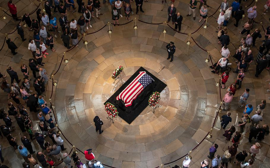 A steady stream of visitors pass through the U.S. Capitol's Rotunda where the late Sen. John McCain was lying in state on Friday, Aug. 31, 2018, in Washington.