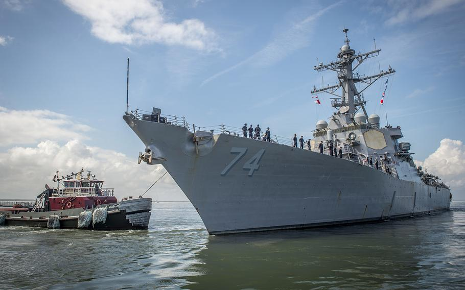 The guided-missile destroyer USS McFaul departs Naval Station Norfolk in preparation for Hurricane Florence, Sept. 10, 2018.