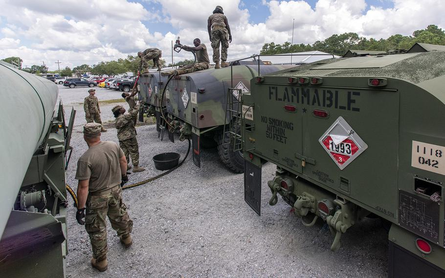 South Carolina National Guard Soldiers from the 118th Forward Support Company transfer bulk diesel fuel into M987 HEMTT fuel tanker trucks for distribution in preparation to support partnered civilian agencies and safeguard the citizens of the state in advance of Hurricane Florence, in North Charleston, S.C., September 10, 2018.