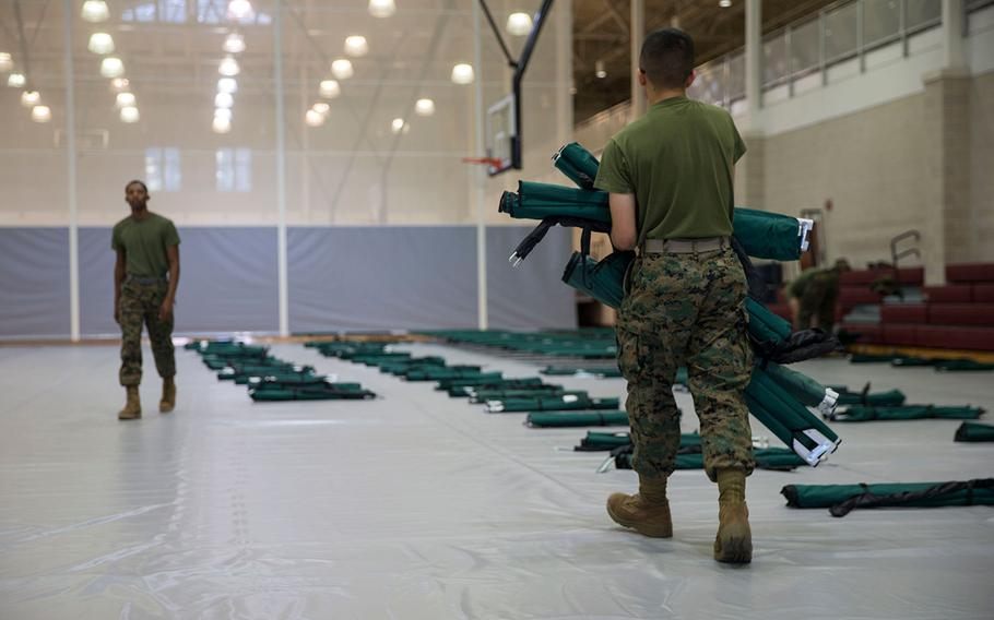 Marines at Camp Lejeune set up cots at the Wallace Creek Fitness Center on Sept. 11, 2018 in anticipation of Hurricane Florence making landfall.