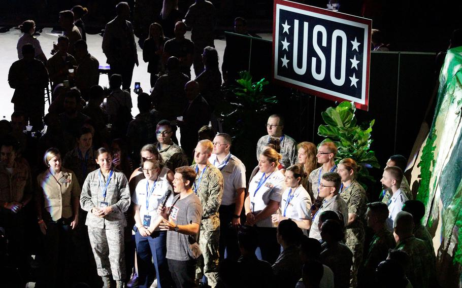 """Comedian Adam Devine hosts """"The World's Biggest USO Tour"""" at The Anthem theater in Washington on Wednesday, Sept. 12, 2018."""