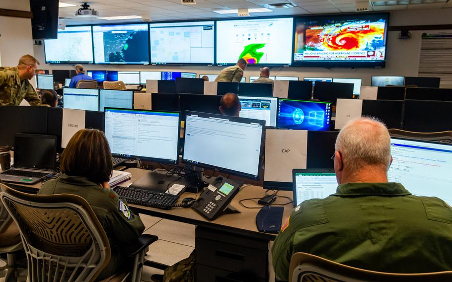 Members of the West Virginia Army and Air National Guard monitor and coordinate movement of National Guard assets and requests for assistance Sept. 13, 2018, at the West Virginia State Emergency Operations Center (SEOC) located at the WVNG Joint Force Headquarters (JFHQ) in Charleston, West Virginia.