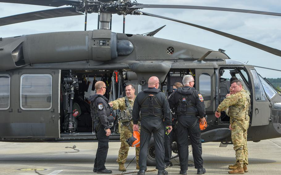 South Carolina National Guard soldiers and rescue workers with the South Carolina Helicopter Aquatic Rescue Team program and South Carolina Urban Search and Rescue Task Force 1 prepare to leave from McEntire Joint National Guard Base in South Carolina for Charleston, South Carolina ahead of Hurricane Florence on Sept. 13, 2018.