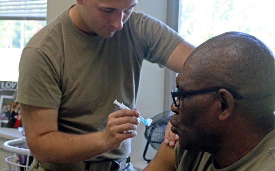 A Fort Drum soldier administers a vaccine to a 548th Combat Sustainment Support Battalion soldier on Thursday, Sept. 13, 2018 in preparation for Hurricane Florence. They were preparing for rapid deployment to areas struck by the storm.