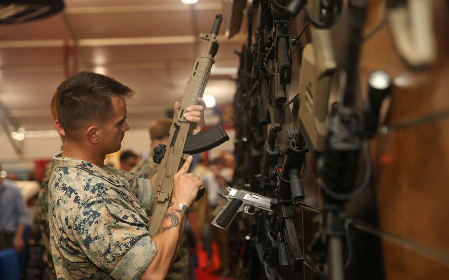 A Marine handles a weapon during the Modern Day Marine military expo at Lejeune Field, Marine Corps Base Quantico in Virginia on Sept. 25, 2018.