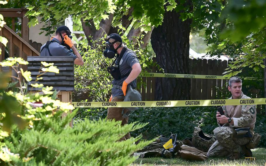 Law enforcement officers search a house on Wednesday, Oct. 3, 2018, in Logan, Utah.