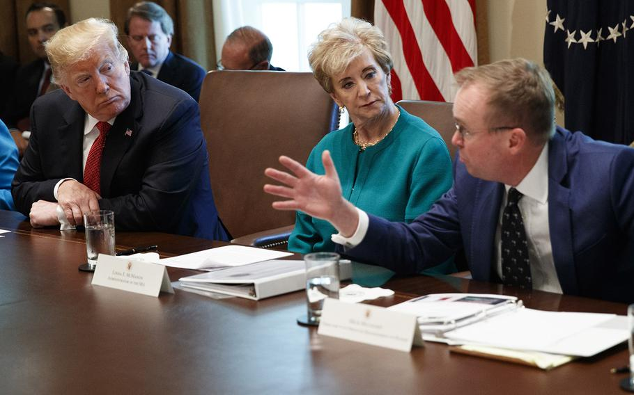 President Donald Trump and Small Business Administration administrator Linda McMahon listen as Director of the Office of Management and Budget Mick Mulvaney speaks during a cabinet meeting in the Cabinet Room of the White House, Wednesday, Oct. 17, 2018.