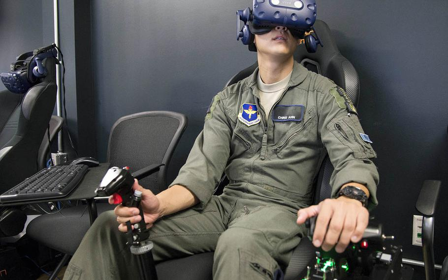 A Pilot Training Next student trains on a virtual-reality flight simulator at the Armed Forces Reserve Center in Austin, Texas, June 21, 2018.