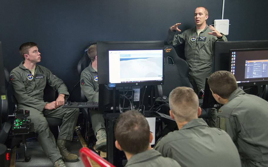 Air Force Capt. Johnathan Joern, a Pilot Training Next instructor, speaks to students about flying procedures at the Armed Forces Reserve Center in Austin, Texas, June 22, 2018.