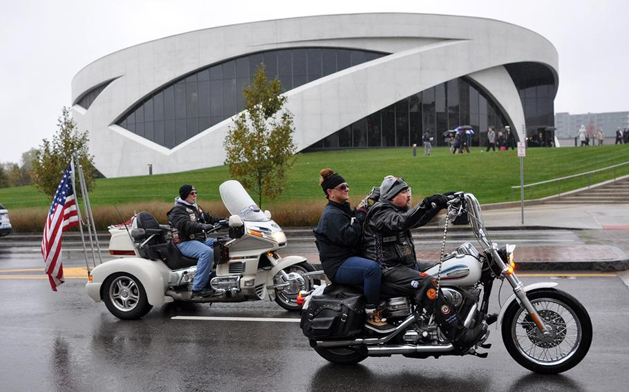 Patriot Guard riders drive by the new National Veterans Memorial and Museum on Saturday as part of a grand opening ceremony. Hundreds of people attended the event, despite rain.