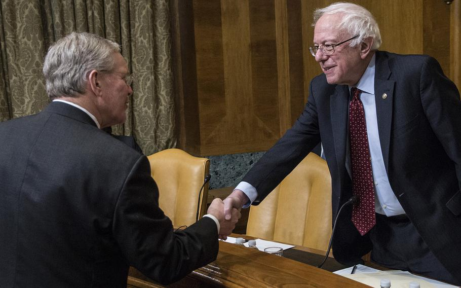Pentagon CMO John H. Gibson II shakes hands with Sen. Bernie Sanders, I-Vt., before a hearing in March, 2018.