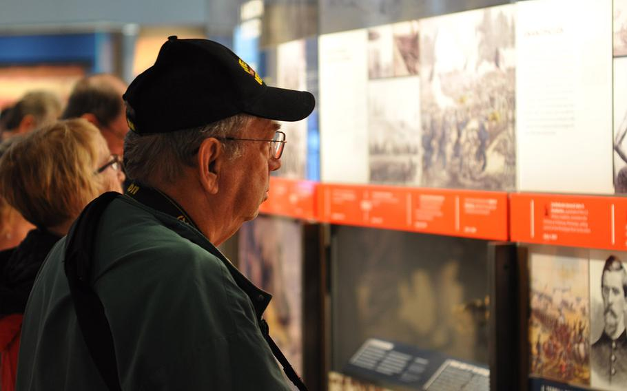 Visitors to the new National Veterans Memorial and Museum in Columbus, Ohio, read through the exhibits Sunday, Oct. 28. The museum, which opened Saturday, aims to share stories of individual veterans from different backgrounds, military branches and eras.