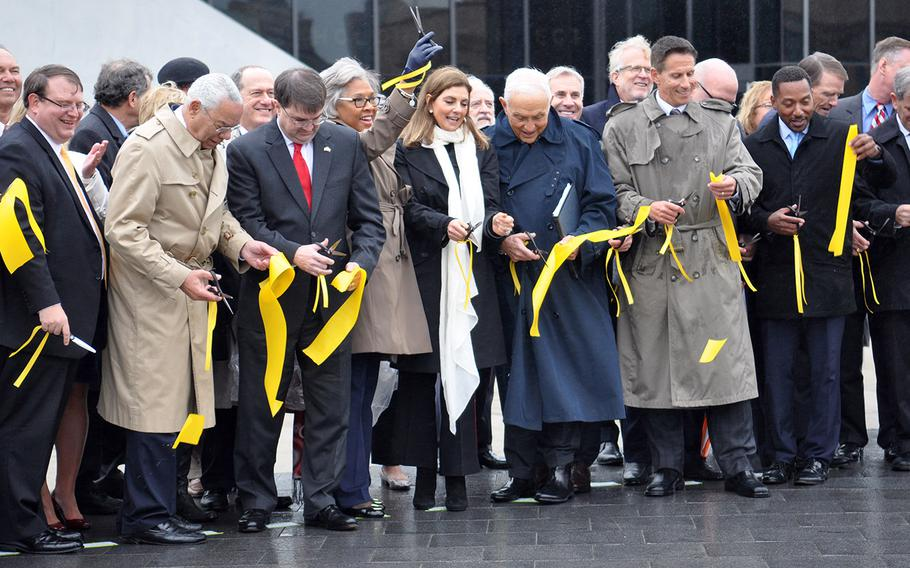 """Rep. Joyce Beatty, a Democrat representing Ohio in the U.S. House, holds up her scissors in celebration during the grand opening of the National Veterans Memorial and Museum in Columbus on Saturday, Oct. 27. Beatty, along with the rest of Ohio's congressional delegation, lobbied Congress to designate the facility a """"national"""" site."""
