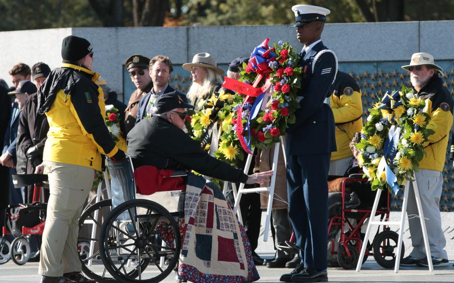 World War II veterans and veterans honoring servicemembers from that era laid wreaths at the National World War II Memorial in Washington, D.C., as part of the Veterans Day remembrances held throughout the city on Sunday, Nov. 11, 2018.