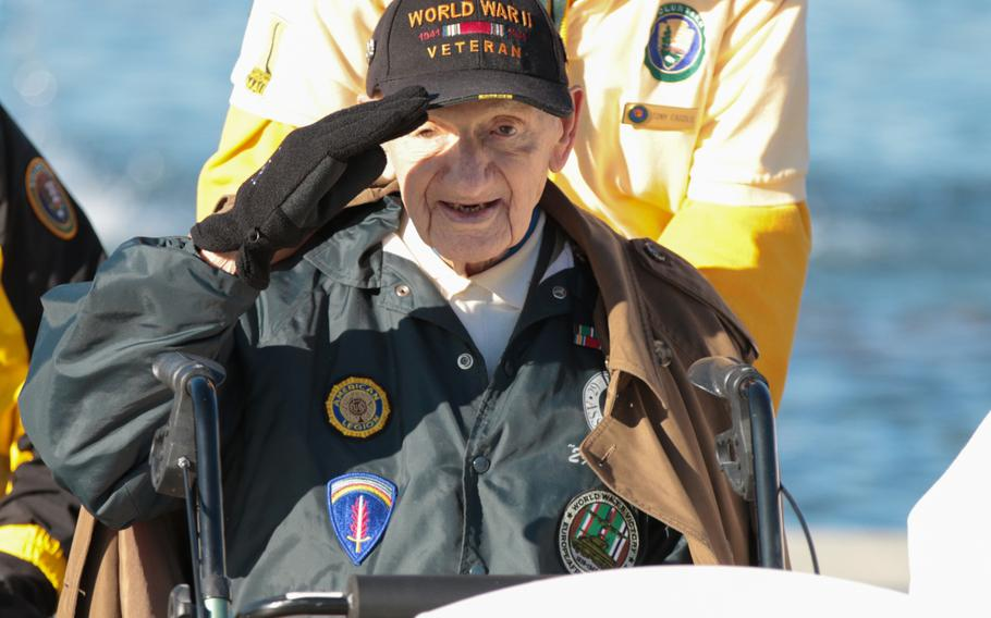 Norman Duncan, a World War II veteran, renders a salute during a wreath-laying ceremony held in honor of Veterans Day at the National World War II Memorial in Washington, D.C., on Sunday, Nov. 11, 2018.