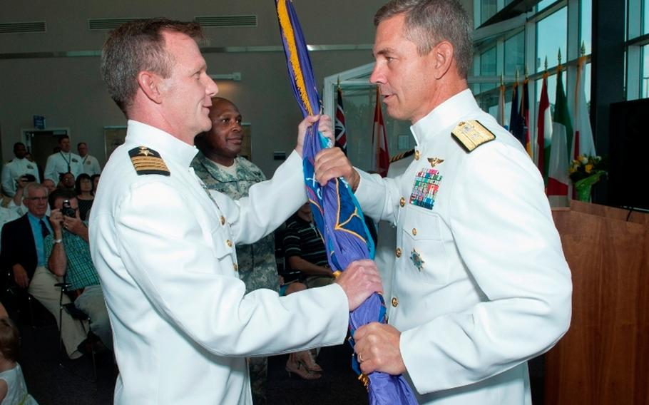 Retired U.S. Navy captain Jeffrey Breslau (left) pleaded guilty in federal court in San Diego on Thursday to a criminal conflict of interest charge in the 'Fat Leonard' corruption scandal.