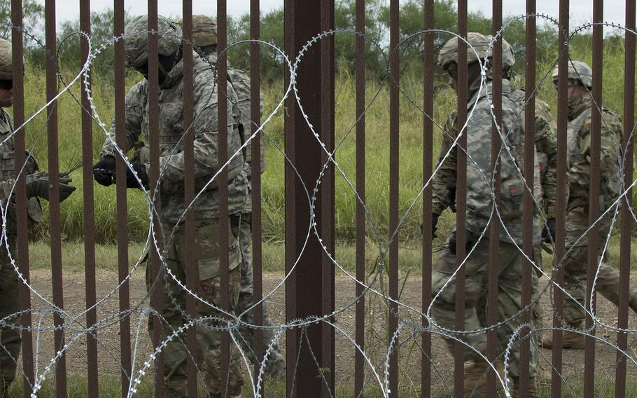 U.S. Army engineers from the 887th Engineer Support Company apply concertina wire in the Brownsville area Nov. 13, 2018.