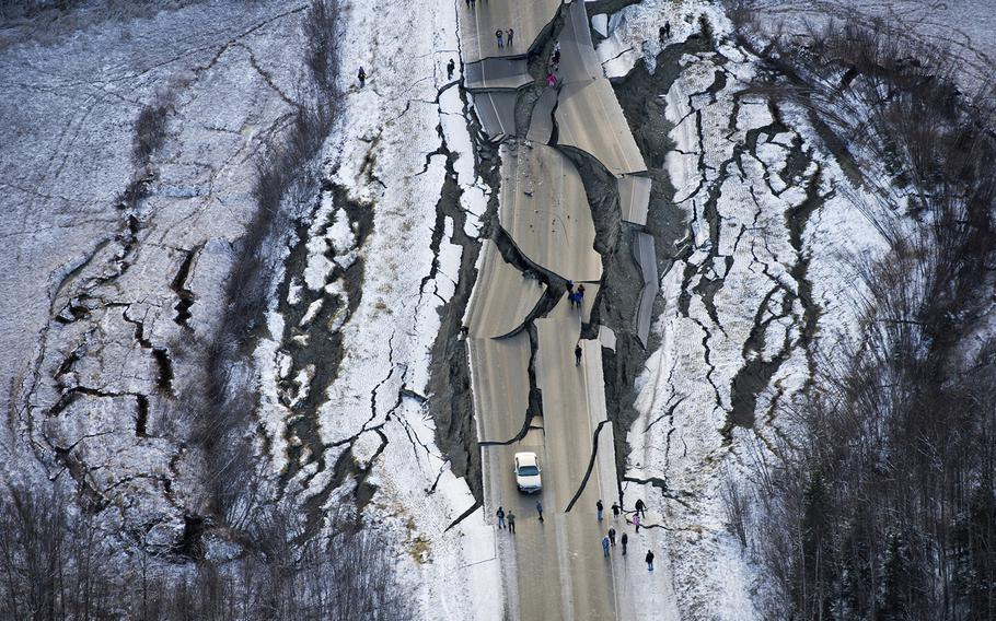 An aerial view shows damage on a road south of Wasilla, Alaska, after earthquakes Friday, Nov. 30, 2018.