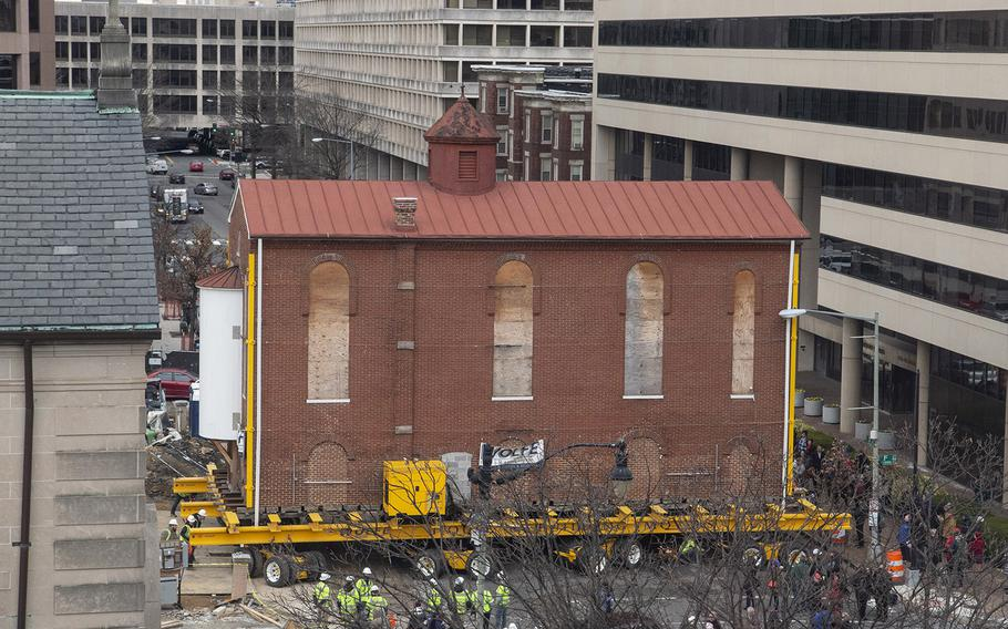 Washington's oldest synagogue building is turned sideways as it arrives at its permanent location at the Lillian and Albert Small Jewish Museum site on January 9, 2019.