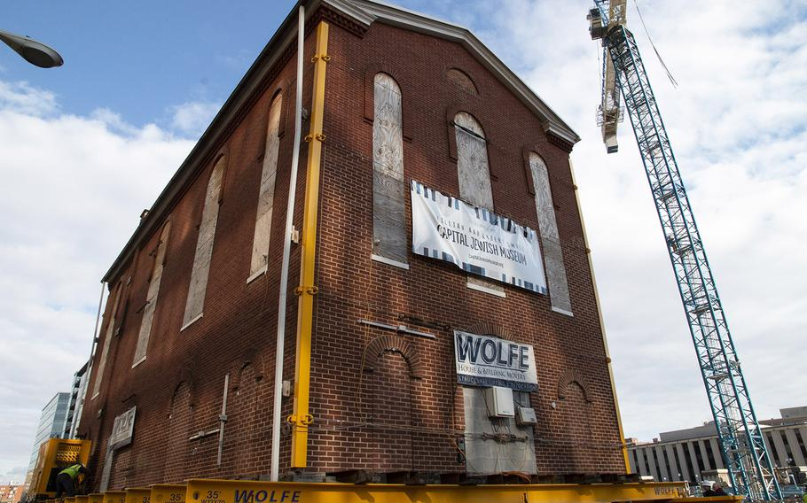 Washington's oldest synagogue building is moved down 3rd St. Northwest to its permanent location at the Lillian and Albert Small Jewish Museum site on January 9, 2019.