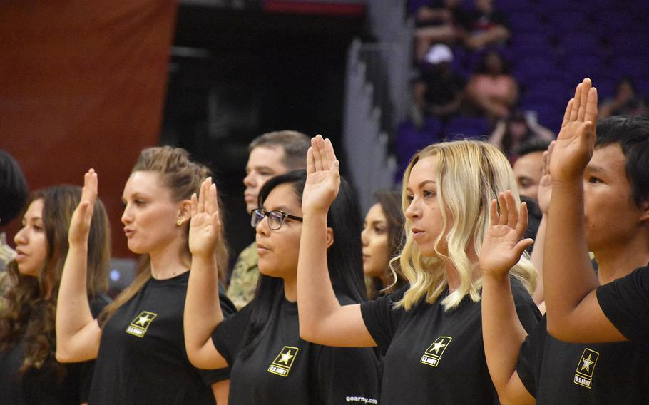 Future soldiers from the Phoenix Recruiting Battalion participate in a mass oath of enlistment ceremony on July 19, 2018,