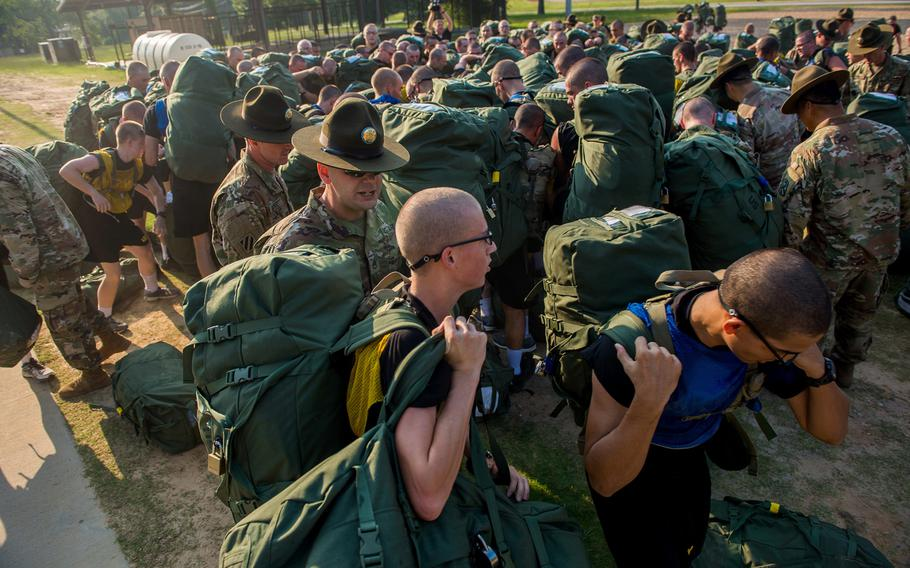 Initial entry trainees arrive at Echo Company, 2nd Battalion, 19th Infantry Regiment, on Fort Benning, Ga., on July 13, 2018, for the first day of the 22-week pilot program for One Station Unit Training for infantry soldiers.