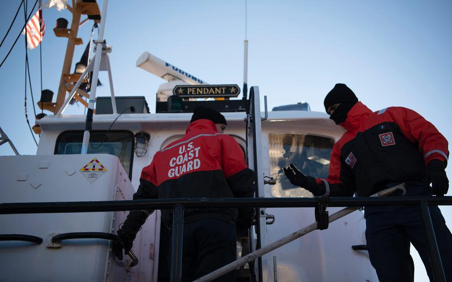 The crew of Coast Guard Cutter Pendant, a 65-foot Small Harbor Tug based out of Boston, makes preparations to get underway to break ice on the Weymouth Fore River, Tuesday, Jan. 22, 2019. The Coast Guard was able to pay its members their Dec. 31 paychecks, but missed their next payday on Jan. 15 and may miss the Feb. 1 paycheck due to the government shutdown.