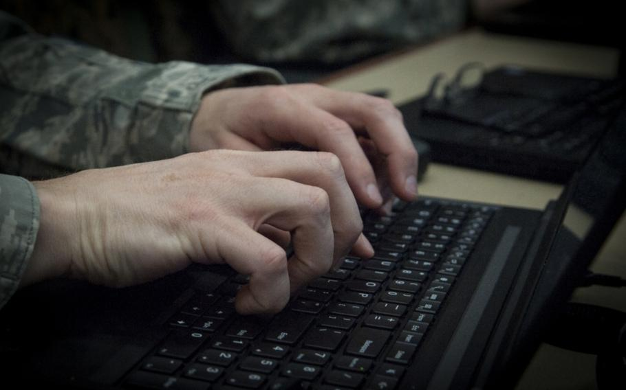 An airman types on his computer during the Cybersecurity Foundry Course at MacDill Air Force Base, Fla., March 9, 2018.