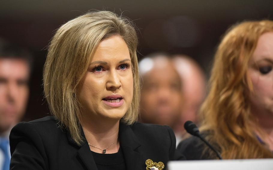 Marine Corps spouse Crystal Cornwalll testifies Wednesday, Feb. 13, 2019, during a Senate hearing on Capitol Hill in Washington where lawmakers heard disturbing stories of poor conditions in military housing.