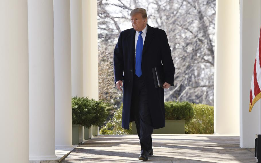 President Donald Trump walks out to speak during an event in the Rose Garden at the White House in Washington, Friday, Feb. 15, 2019, to declare a national emergency in order to build a wall along the southern border.