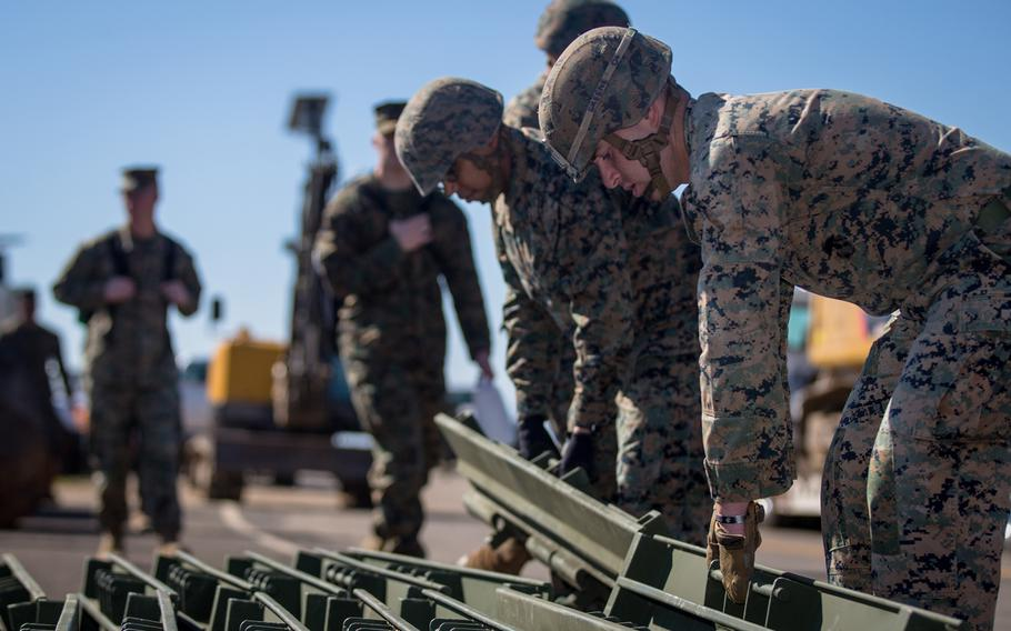 Marines from the 7th Engineer Support Battalion, 1st Marine Logistics Group lay down curves from a medium girder bridge on Carnes Road at Marine Corps Base Camp Pendleton, California, Feb. 7, 2019.