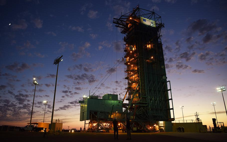 In a Sept. 14, 2018 file photo, technicians gather around Space Launch Complex Two while making preparations to launch a United Launch Alliance Delta II rocket carrying NASA's Ice, Cloud, and Land Elevation Satelite II, on Vandenberg Air Force Base, Calif.