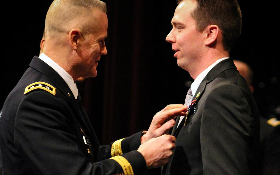 Lt. Gen. Thomas James, Jr., commander of First Army, pins Andrew Bundermann with the Distinguished Service Cross.
