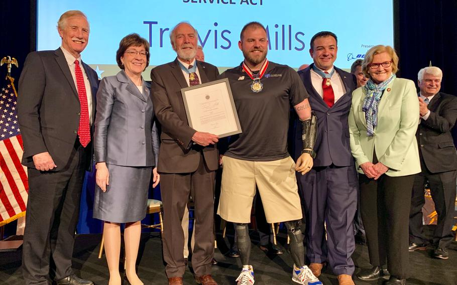 Travis Mills, center, was awarded the 2019 Citizen Honors Service Act Award on Monday, March 25, 2019, for his work with the Travis Mills Foundation, which provides getaways for veterans suffering from service-related injuries.