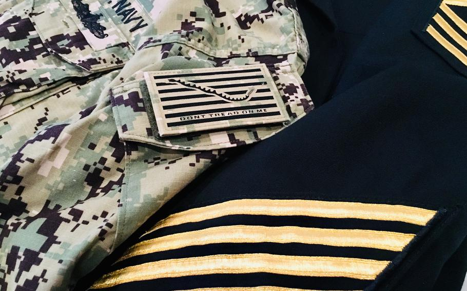 The Navy released a new uniform policy update. Dress and service uniform gold chevrons for 12-year sailors and the long-awaited type III uniform command patches are among the list.