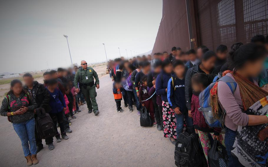 U.S. Border Patrol agents assigned to El Paso Station corral a group of approximately 127 migrants at the U.S.-Mexico border, March 7, 2019.