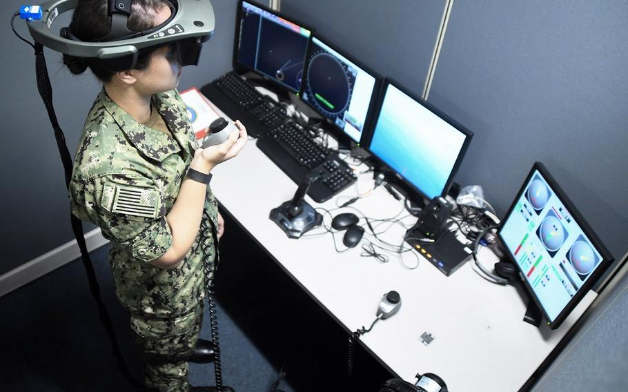 In a July, 2018 file photo, a Basic Division Officer Course student at Surface Warfare Officers School, Det. San Diego, practices navigation in the Conning Officer Virtual Environment (COVE) shiphandling simulator, which provides state-of-the-art navigation and shiphandling training and can emulate the Navy's homeports and almost every routine port of call around the world. Constructing better training simulators for sailors on surface ships is one of the initiatives being undertaken by the Navy.