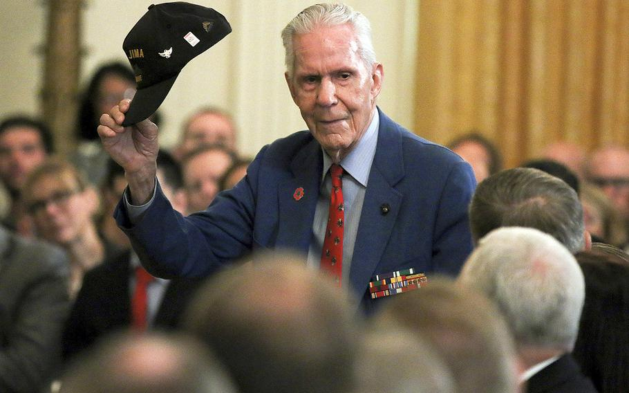 James Blane, a Marine Corps veteran who fought on Iwo Jima during the Pacific campaign of World War II, stands to applause at a White House event honoring wounded veterans, Thursday, April 18, 2019.