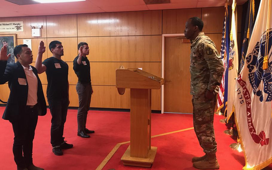 Cesar Vargas (left) participates in an Army Oath of Enlistment ceremony in 2018.
