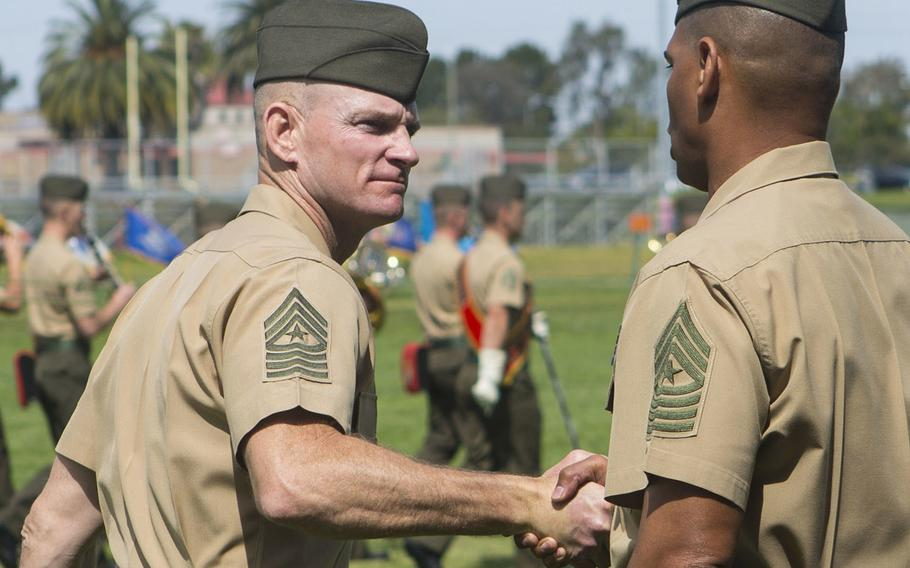 U.S. Marine Sgts. Maj. Troy E. Black, left, and Lonnie N. Travis shake hands after a ceremony at Camp Pendleton, Calif., April 7, 2017.