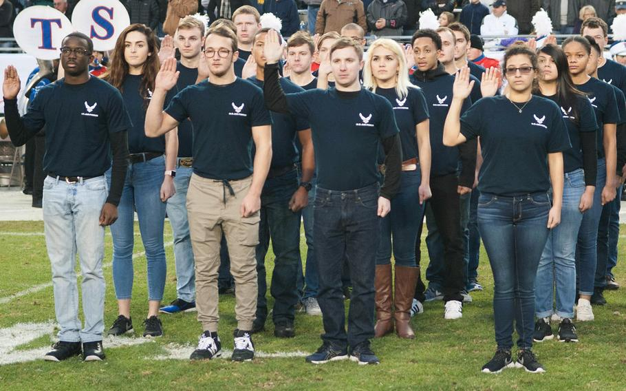 Air Force recruits are sworn into military service at Amon G. Carter Stadium, Fort Worth, Texas, Dec. 23, 2016.