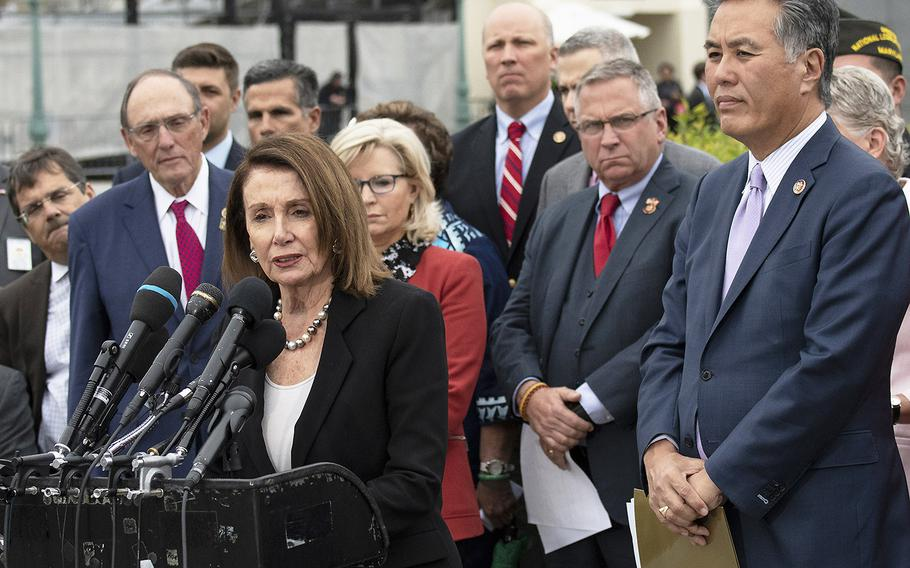 House Speaker Nancy Pelosi, D-Calif, speaks at a Capitol Hill press conference on veteran suicide, April 29, 2019. At right is House Veterans' Affairs Committee Chairman Mark Takano, D-Calif.