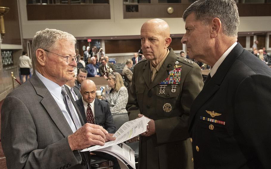 Senate Armed Services Committee Chairman James Inhofe, R-Okla, talks with Marine Corps Commandant nominee Lt. Gen. David H. Berger and Chief of Naval Operations nominee Adm. William F. Moran before their confirmation hearing on Capitol Hill, Apr. 30, 2019.