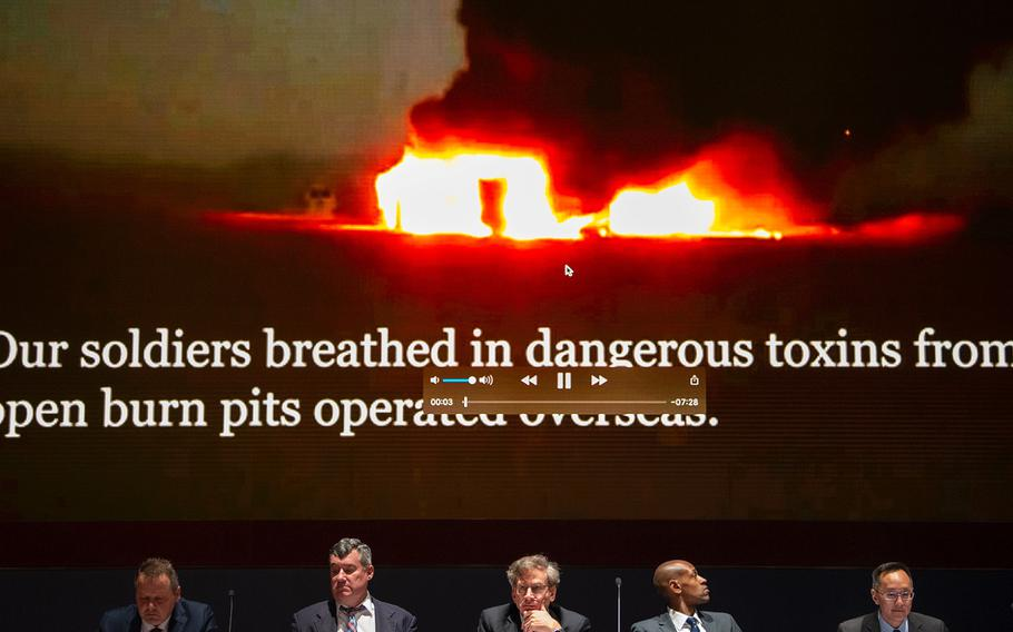 A panel of experts look on during a briefing at the U.S. Capitol in Washington on Tuesday, April 30, 2019, at the start of a short documentary video on troops who suffered from exposure to toxins released from burn pits at overseas locations.