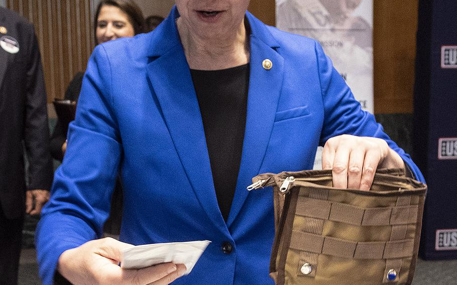 Sen. Tammy Baldwin, D-Wis., prepares a snack package for U.S. servicemembers during a USO event at the Dirksen Senate Office Building on Capitol Hill, April 30, 2019.