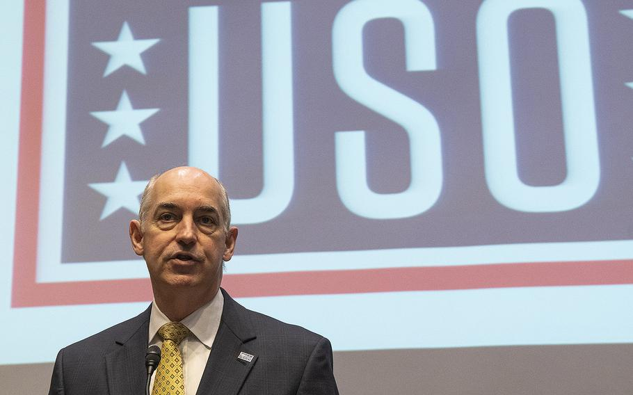 USO President and CEO J.D. Crouch II speaks to volunteers preparing snack packages for U.S. servicemembers during an event at the Dirksen Senate Office Building on Capitol Hill, April 30, 2019.