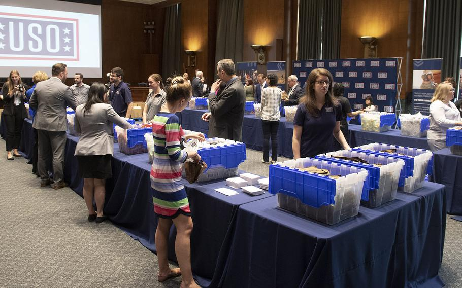 Volunteers prepare snack packages for U.S. servicemembers during a USO event at the Dirksen Senate Office Building on Capitol Hill, April 30, 2019.