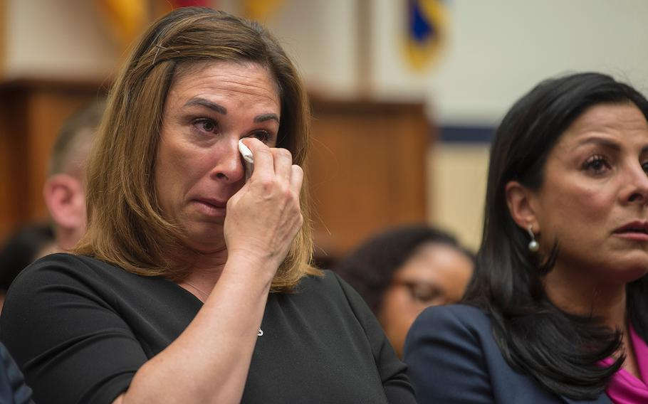 Megan Stayskal wipes away tears as her husband Army Green Beret Sgt. 1st Class Richard Stayskal testifies during a hearing on Capitol Hill in Washington on Tuesday, April 30, 2019.