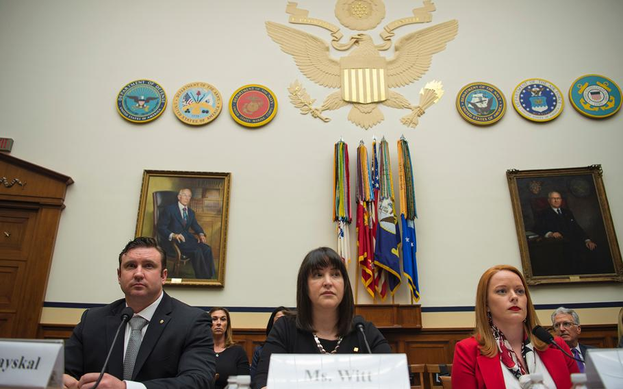 Army Green Beret Sgt. 1st Class Richard Stayskal, Alexis Witt, widow of Air Force Staff Sgt. Dean Witt, and Air Force veteran Rebecca Lipe take their seats as they prepare to testify during a hearing on Capitol Hill in Washington on Tuesday, April 30, 2019.