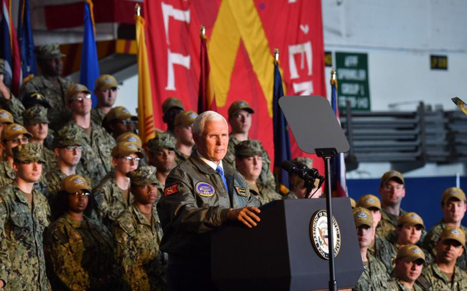 Vice President Mike Pence speaks to sailors at an all-hands call aboard the Nimitz-class aircraft carrier USS Harry S. Truman.